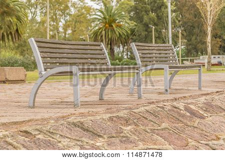Wooden Chairs At The Boardwalk Of Santa Lucia River In Montevideo Uruguay