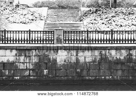Old Brick Embankment With Stairs In Winter