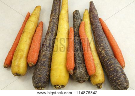 Raw Purple Yellow And Orange Carrots
