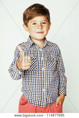 little cute real boy on white background gesture smiling close up