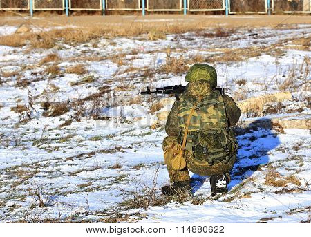 MOSCOW REGION - JANUARY 29: Infantryman with a submachine gun in combat gear monitors the battlefield  on January 29, 2015 in Moscow Region