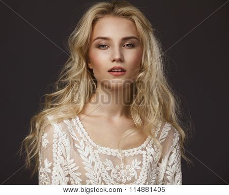 Studio portrait of a beautiful young blond woman