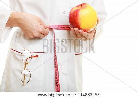 Doctor Specialist Holding Fruit Apple Measuring Waist