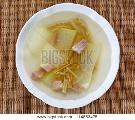 Fresh Pork And Cabbage Soup On Bamboo Mat Background