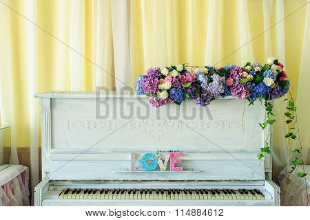 White vintage pianino with Love latters