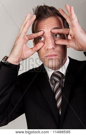 Businessman trying to stay awake