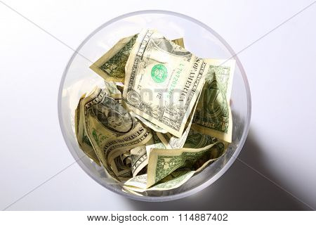 Tip Jar. Cash tips in a clear plastic Tip Jar. Tips are a token of appreciation for a Job Well Done for services. Tips are well appreciated by all who get them. Cash is King.