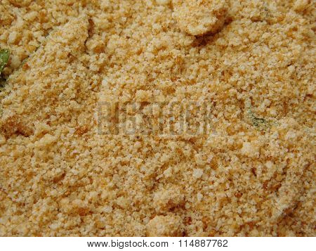 to bread crumb on a wooden base in the kitchen