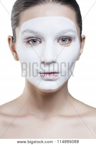 young pretty woman with facial white mask isolated close up spa