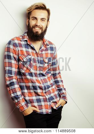 portrait of young bearded hipster guy smiling on white background close up