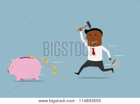 Fast businessman trying to smash a piggy bank