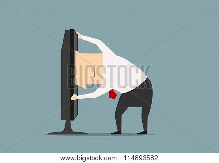 Businessman stuck in computer monitor