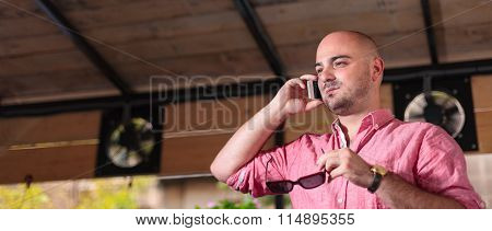 Young Bald Man Talking On The Phone - Letterbox
