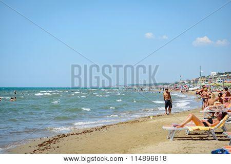 People Enjoy On The Beach