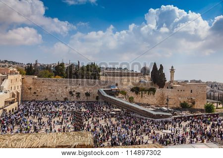 The area in front of Western Wall of Temple filled with people. Jerusalem, the Jewish holiday of Sukkot