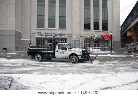 Truck With Plow Clears Snow