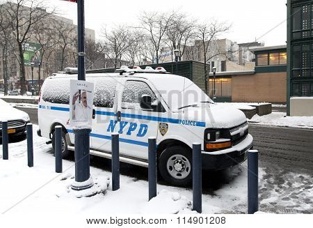 Police Vehicle Parked With Snow