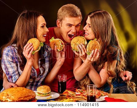 Small group people holding hamburgers and drinks cola .
