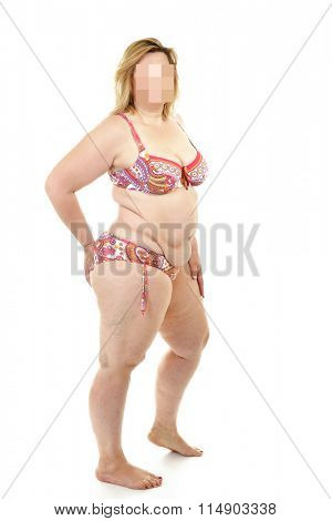 Overweight woman wearing swimsuit, over white background.