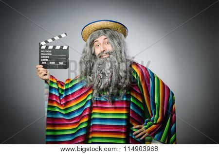 Funny hairy mexican with movie clapper