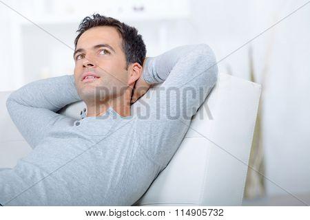 Pensive man on sofa