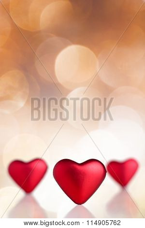 Red Valentine hearts with bokeh background