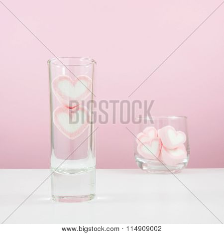The lovely pink heart marshmallows in small narrow glass and small round glass