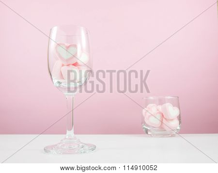 The lovely pink heart marshmallows in wine glass and small round glass