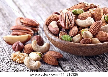 Dried nuts on a wooden background