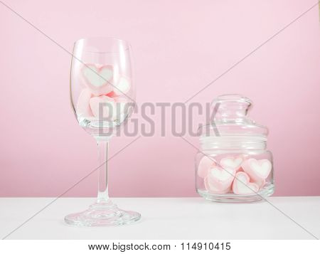The lovely pink heart marshmallows in wine glass and small glass jar