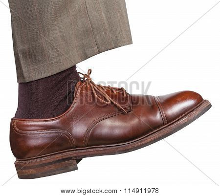 Male Right Leg In Brown Shoe Takes A Step