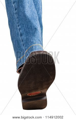 Direct View Of Left Leg In Jeans And Brown Shoe