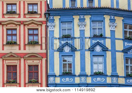Facade of two colorful ornate houses in Prague, Czech Republic.
