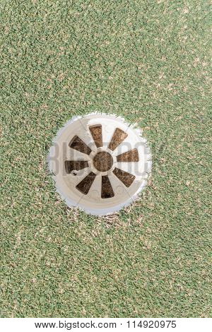 Aerial View Of Golf Hole On Green Grass Golf Course.