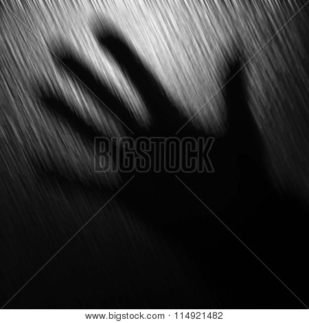 Blurred black and white background with one hand.