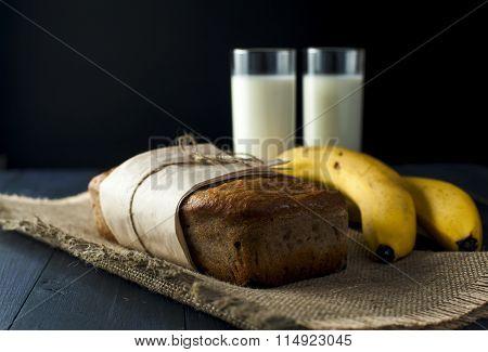 Banana bread, glasses of milk on burlap napkin