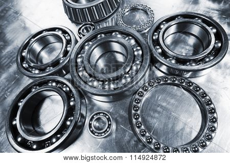 ball-bearings, pinions against brushed aluminum, titanium and steel aerospace parts