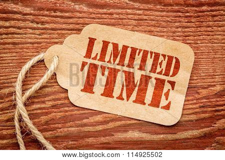 limited time offer sign - red stencil text on a paper price tag against rustic wood
