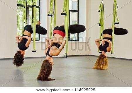 Antigravity yoga exercise. group of girls