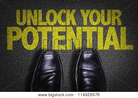 Top View of Business Shoes on the floor with the text: Unlock Your Potential