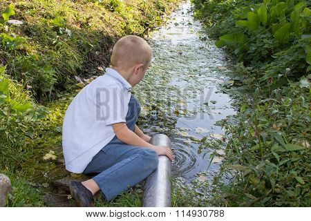 Boy takes water from pipes