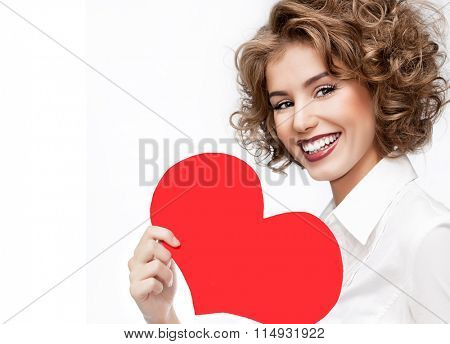 beauty portrait of young caucasian smiling happy woman make up face isolated on white studio shot red heart valentine's love