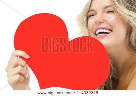 portrait of attractive  caucasian smiling woman blond isolated on white studio shot  toothy smile face long hair head and shoulders red heart valentine's love