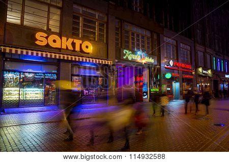 RIGA, LATVIA - DECEMBER 20, 2015: People walking in old town at evening on December 20, 2015 in Riga, Latvia