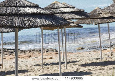 Detail Of Woven Umbrellas Above Rows On Beach In Cyprus.