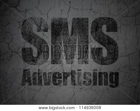Marketing concept: SMS Advertising on grunge wall background
