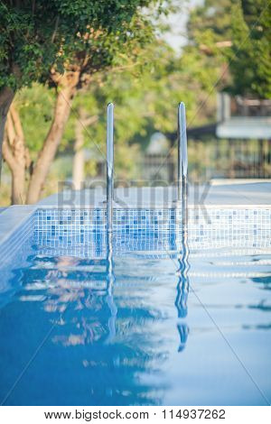 Outdoor swimming pool with shiny water