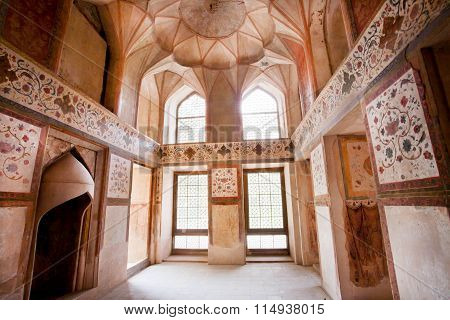 Room With Fireplace And Faded Frescoes On The Walls Of Historical Palace In Isfahan