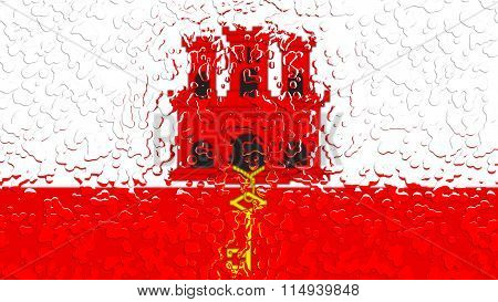 Flag of Gibraltar painted with water drops