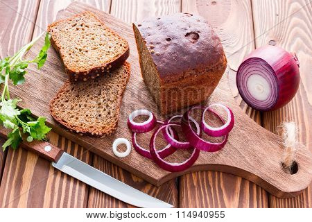 Bread With Bran And Vegetables On A Cutting Board